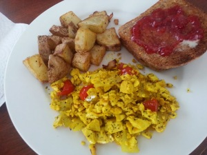 Tofu scramble with home fries toast.
